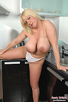 Cherry B plays with her hooters and fucking with a big dildo from Busty Britain
